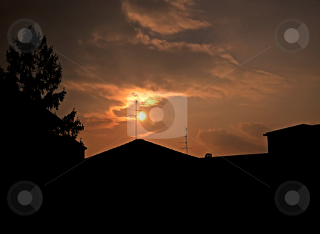 Sunset on the city stock photo, Silhouette of a city with sunset sky by Fabio Alcini