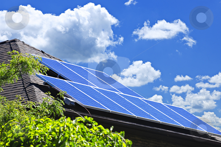 Solar panels stock photo, Array of alternative energy photovoltaic solar panels on roof of residential house by Elena Elisseeva