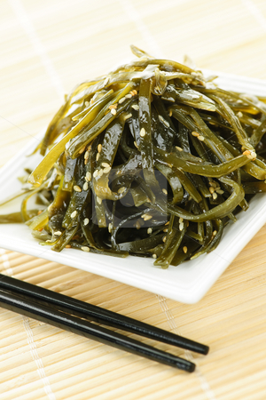 Seaweed salad stock photo, Plate of wakame seaweed salad with chopsticks by Elena Elisseeva