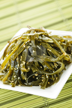 Seaweed salad stock photo, Plate of seaweed and sesame seed salad by Elena Elisseeva
