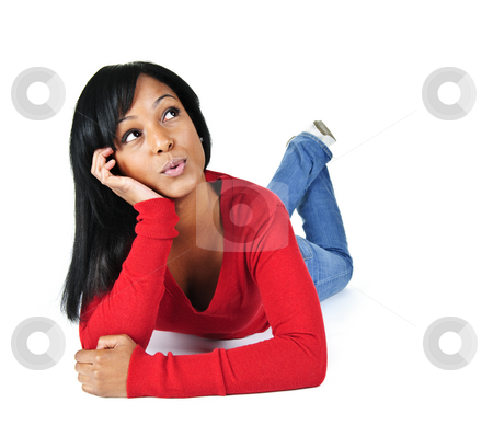 Young woman relaxing looking up stock photo, Portrait of black woman looking up and laying on white background by Elena Elisseeva