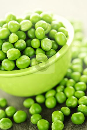 Bowl of green peas stock photo, Closeup on bowl of fresh green organic green peas by Elena Elisseeva