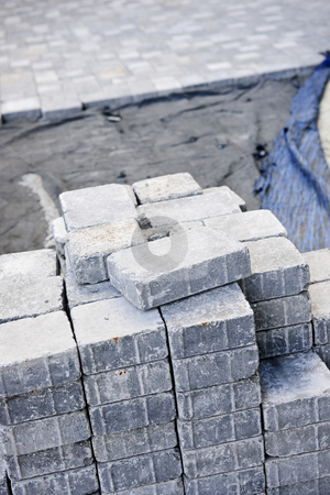Interlocking stone driveway stock photo, Stacks of interlocking stones for installing driveway landscaping by Elena Elisseeva