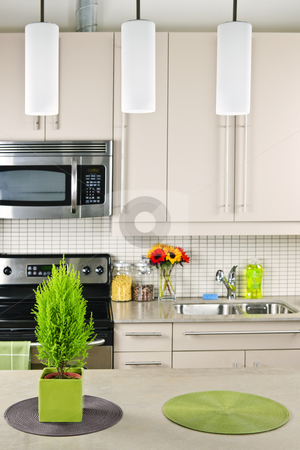 Kitchen interior stock photo, Modern kitchen interior with natural stone countertop by Elena Elisseeva