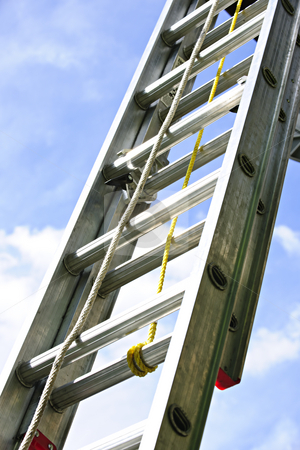 Construction ladder stock photo, Closeup of construction aluminum extension ladder against blue sky by Elena Elisseeva