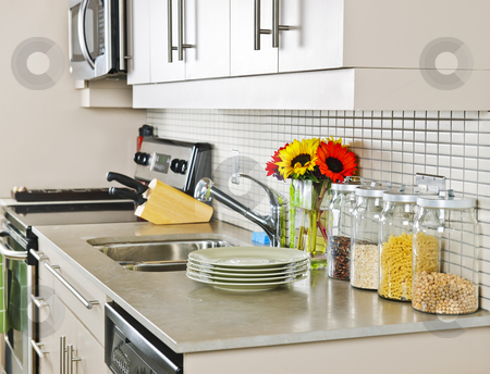 Kitchen interior stock photo, Modern small kitchen interior with natural stone countertop by Elena Elisseeva