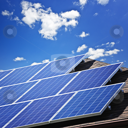 Solar panels stock photo, Array of alternative energy photovoltaic solar panels on roof by Elena Elisseeva