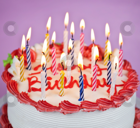 Birthday cake with lit candles stock photo, Birthday cake with burning candles and icing by Elena Elisseeva