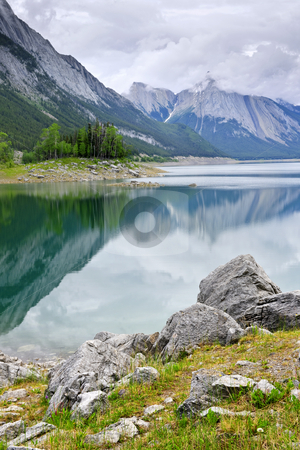 Mountain lake in Jasper National Park stock photo, Mountains reflecting in Medicine Lake in Jasper National Park, Canada by Elena Elisseeva
