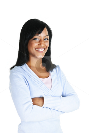 Smiling young woman with crossed arms stock photo, Smiling black woman with arms crossed isolated on white background by Elena Elisseeva