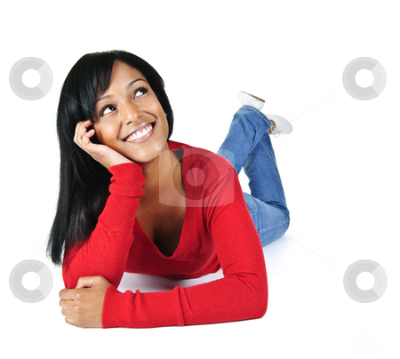 Smiling young woman relaxing looking up stock photo, Portrait of black woman looking up smiling and laying on white background by Elena Elisseeva