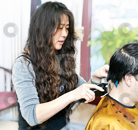 Hairstylist working stock photo, Hairdresser cutting hair in her salon with trimmer by Elena Elisseeva