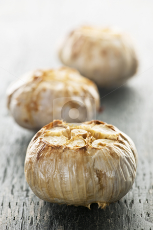 Roasted garlic bulbs stock photo, Close up of fresh roasted garlic bulbs by Elena Elisseeva