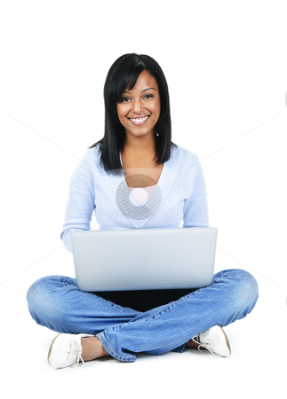 Young woman with computer stock photo, Happy black woman sitting with computer isolated on white background by Elena Elisseeva