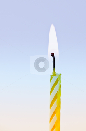 Lit candle stock photo, Flame of a single birthday candle burning by Elena Elisseeva
