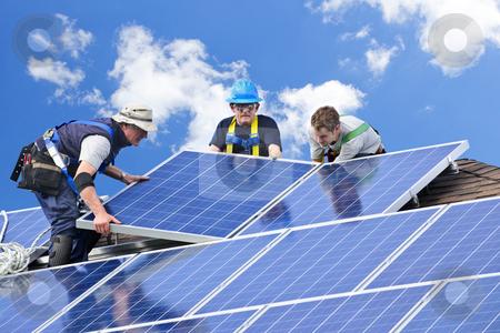 Solar panel installation stock photo, Workers installing alternative energy photovoltaic solar panels on roof by Elena Elisseeva