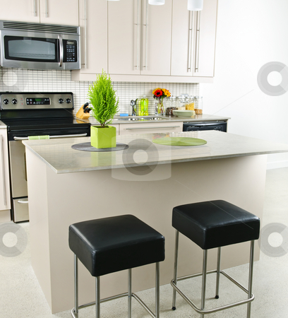 Kitchen interior stock photo, Modern kitchen interior with island and natural stone countertop by Elena Elisseeva