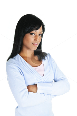 Confident young woman stock photo, Serious black woman with arms crossed isolated on white background by Elena Elisseeva
