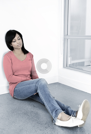 Tired woman sitting on the floor stock photo, Tired black woman sitting against wall with eyes closed by Elena Elisseeva