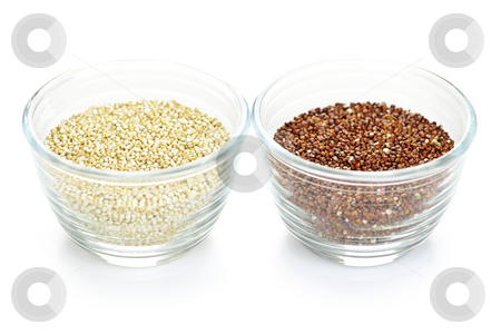 Red and white quinoa grain in bowls stock photo, Red and white quinoa grain in bowls on white background by Elena Elisseeva