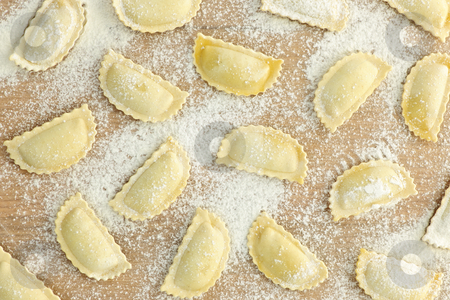 Uncooked ravioli stock photo, Uncooked ravioli pasta prepared and ready for cooking from above by Elena Elisseeva
