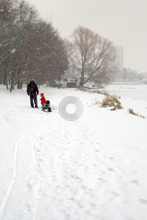 Winter walk stock photo, Father and kinder walking in the park in winter by Vladimir Blinov