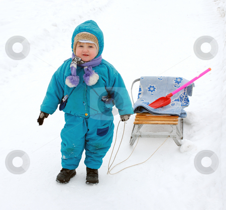 Winter Games Children stock photo, Winter games children - a girl sledding down the hills by Vladimir Blinov