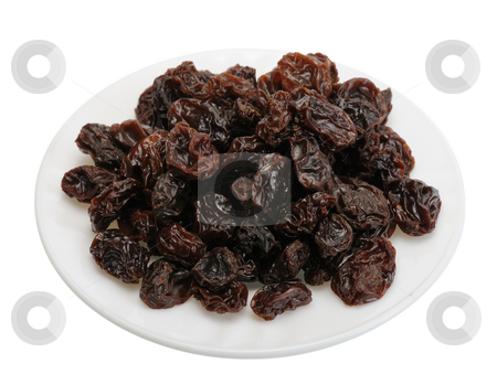 Raisin on a white plate on a white background stock photo, Big brown raisins on a white plate on a white background by Vladimir Blinov
