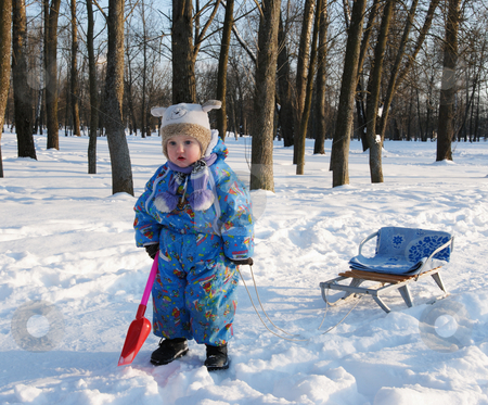 Winter games children stock photo, Winter games children - girl with a sledge in the park by Vladimir Blinov