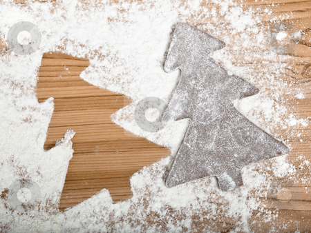 Gingerbread cookie stock photo, Baking homemade Gingerbread cookies with a shape of a christmas tree by ikostudio