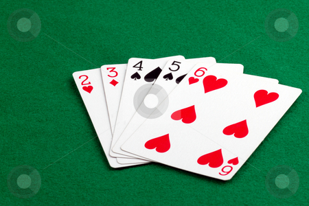Straith stock photo, Poker hand with a straith on green felt by Gert Lavsen