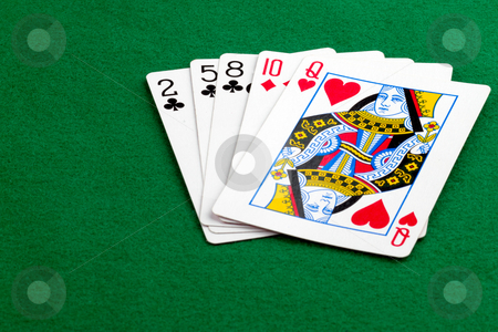 Poker hand high card stock photo, High card poker hand on green background by Gert Lavsen