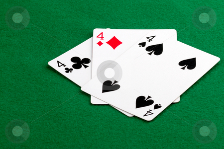 Poker hand with 3 of a kind stock photo, Poker hand with 3 of a kind on green felt by Gert Lavsen