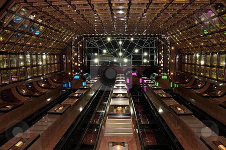 Atrium stock photo, Large atrium with colorfully walls and elevators by Kevin Tietz