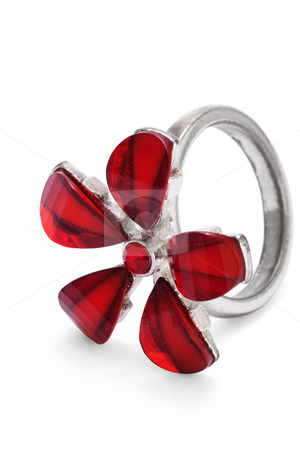 Finger ring with red stone flower isolated stock photo, Finger ring with red stone flower isolated on the white background by Sergey Ochkasov