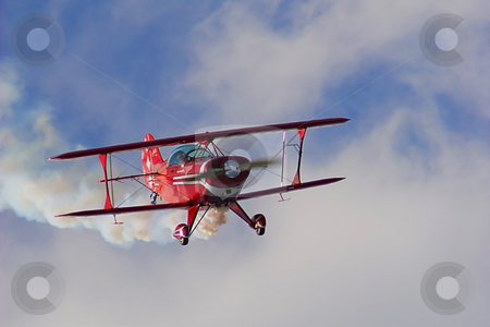 Biplane stock photo, An old red biplane in air show . by Dejan Lazarevic