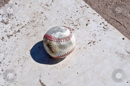 Baseball Close Up on Home Plate stock photo, Baseball Close Up on Home Plate by Brandon Bourdages