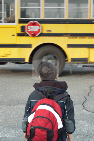 A toddler waiting to catch the school bus stock photo, A toddler waiting to catch the school bus by Arvind Balaraman