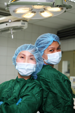 O.r. nurses stock photo, Picture of nurses inside the operating room by Claro Alindogan