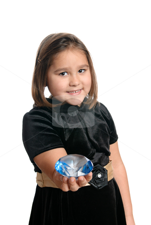 Cute Girl stock photo, A cute little girl is holding out a blue diamond, isolated against a white background. by Richard Nelson