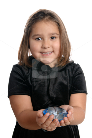 Rich Child stock photo, A rich little girl is showing off a blue diamond, isolated against a white background. by Richard Nelson