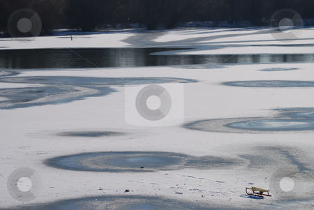 Sledge on snow stock photo, Small frozen river with sledge on snow and ice by zagart