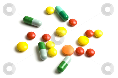 Colourful pills stock photo, Colourful pills isolated on white background by Ingvar Bjork