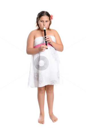 Girl Playing Recorder stock photo, A young girl is wearing a white dress and playing the recorder flute, isolated against a white background by Richard Nelson