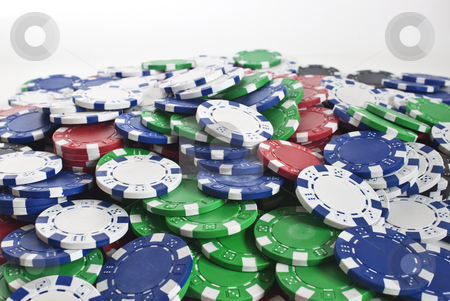 Poker chips scattered stock photo, Lots of poker chips scattered as a background texture by Stephen Clarke