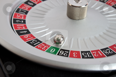 Roulette wheel with grren zero stock photo, Roulette spinning a winning green zero by Stephen Clarke