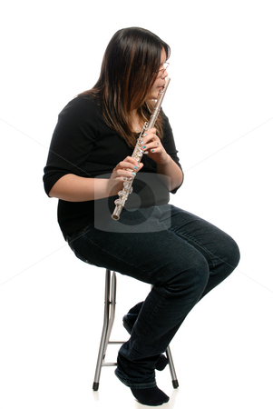 Flute Player stock photo, A teenage girl is sitting on a stool while playing the flute, isolated against a white background. by Richard Nelson