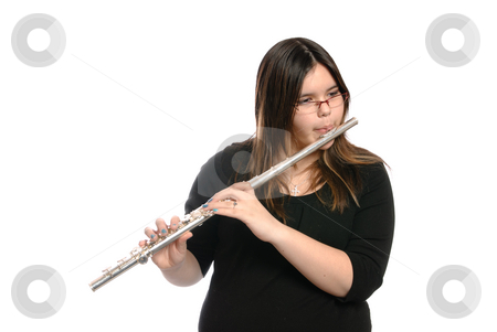 Teenager Playing Flute stock photo, A teenage girl is playing the flute, isolated against a white background. by Richard Nelson