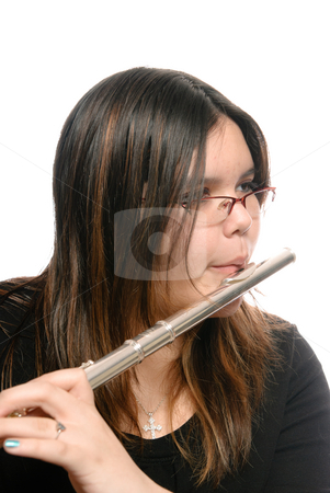 Closeup Flute Playing stock photo, Closeup view of a young girl playing the flute, isolated against a white background. by Richard Nelson