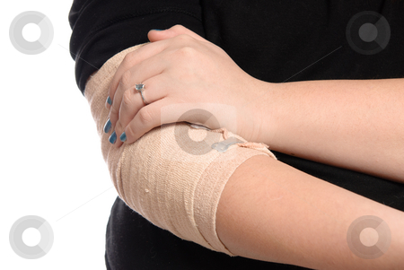 Closeup Elbow Injury stock photo, Closeup view of a young girl holding her  injured elbow, isolated on a white background. by Richard Nelson